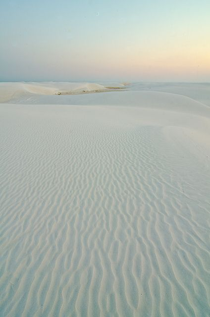 White Sands, New Mexico. I've been here. The sand is so soft & you can sled down the dunes. So much fun :)
