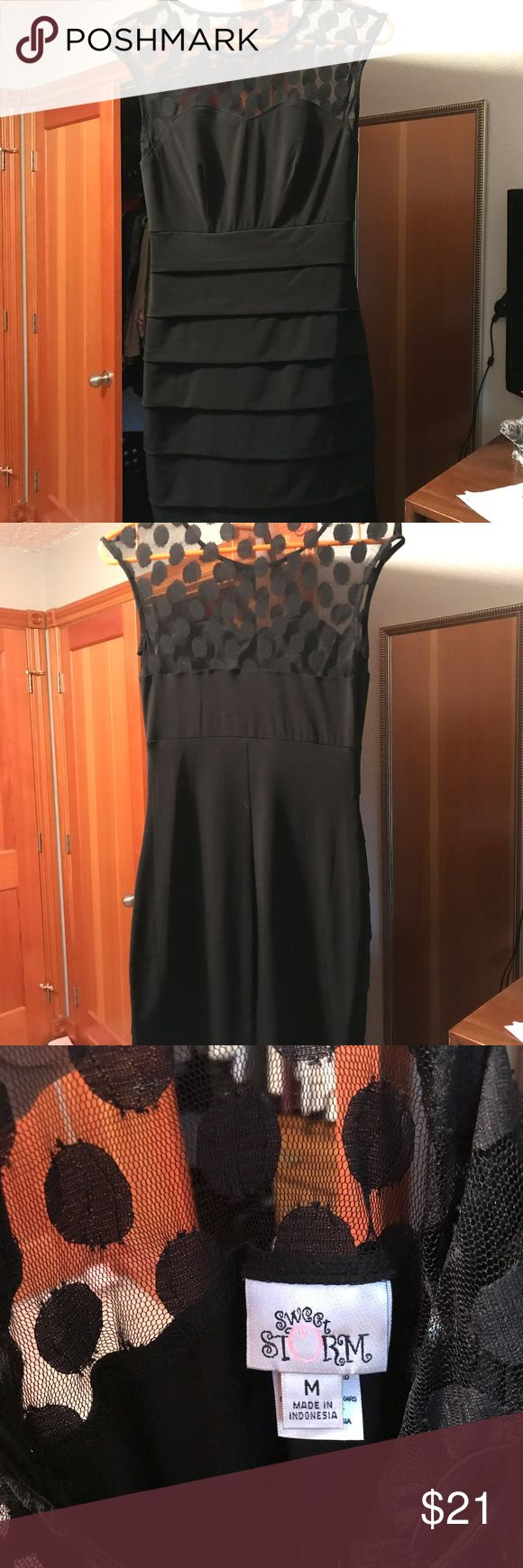Formal dress, black, size medium I bought this for homecoming but ended up not wearing it because it was too short. The top is mesh with polka dots. there are no tears or damages. Dresses Mini