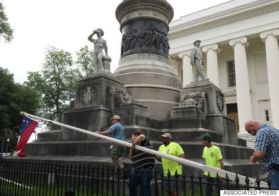 """June 24, 2015 -- Alabama Gov. Robert Bentley (R) ordered the removal of four Confederate-era flags from the grounds of the state Capitol Wednesday morning, saying it was simply """"the right thing to do.""""  -- The flags were part of a confederate memorial at the Capitol in Montgomery. Two state workers came out Wednesday morning and """"with no fanfare quickly and quietly"""" took down the first of the four, the battle flag, according to AL.com."""