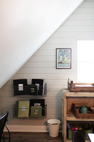 Good idea for metal baskets..keep those albums out! Joanna Gaines's Blog | HGTV Fixer Upper | Magnolia Homes