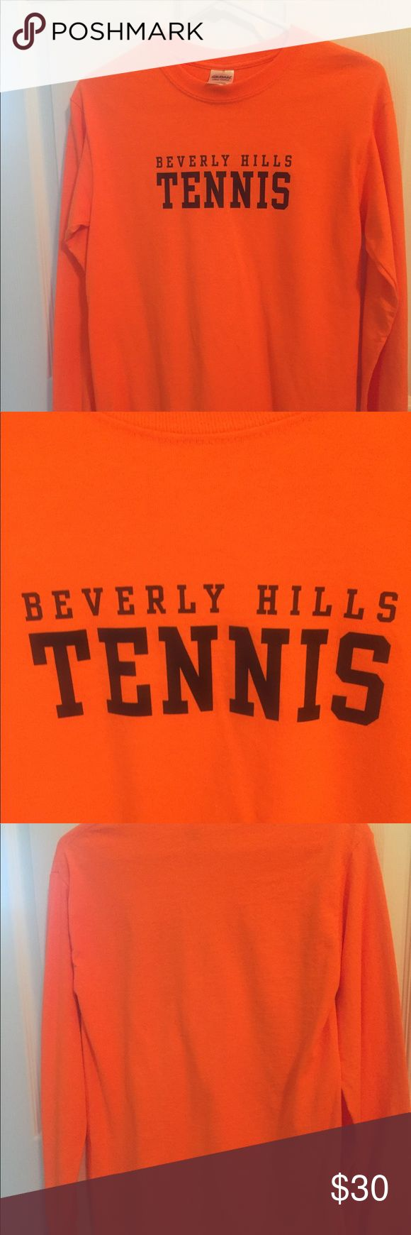 Beverly Hills Tennis T- Shirt This is a long sleeve orange Beverly Hills Tennis T-shirt written in black. It is a size small and only worn once it also has a circle neck line . Beverly Hills Tennis Skirts