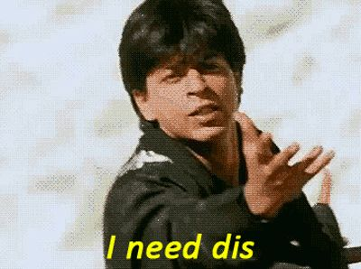 Reacting to pizza commercials. | 31 Relatable Shah Rukh Khan GIFs For Everyday Situations