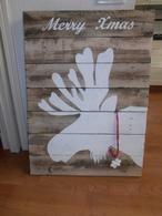 wand bord van pallethout met elandkop beschilderd met muurverf