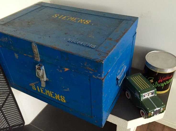 A wooden old box from Siemens with kindling inside. Metal boxes from Hellas and Harrods.