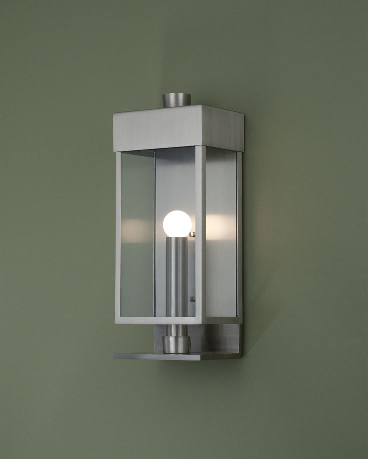 Boyd Lighting's exterior Mar Vista wall sconce was designed by Barbara Barry. It is a modern twist on a carriage lantern. Available in four metal options and in either rippled or clear glass options. Matching interior pendant is available. Can be fitted with nostalgia bulbs and seeded glass for a traditional look, or with globe lights and clear glass for a more contemporary feel. Style: classic, transitional.