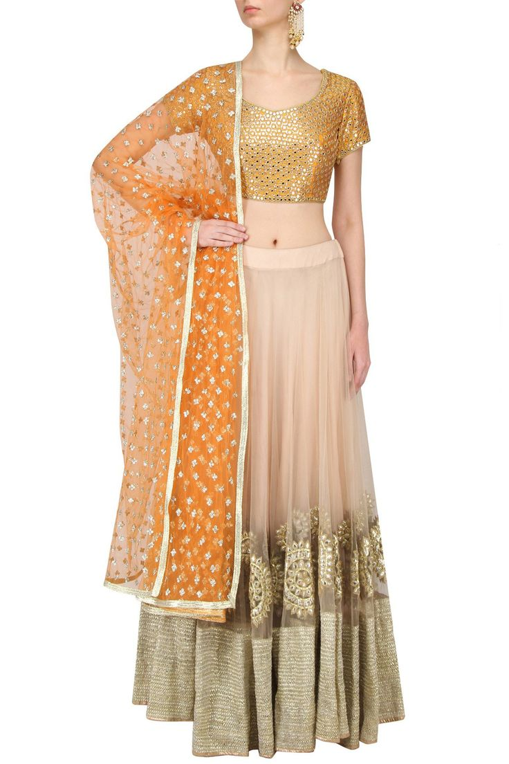 This gorgeous mustard and beige mirror work lehenga set by Umrao Mirza is on flat 40% off. Priced just around 25k. #Frugal2Fab