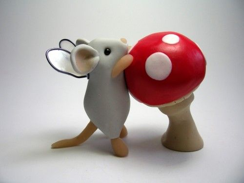 Little Fairy Mouse with Toadstool Sculpture. This would be adorable out of marzipan or fondant!