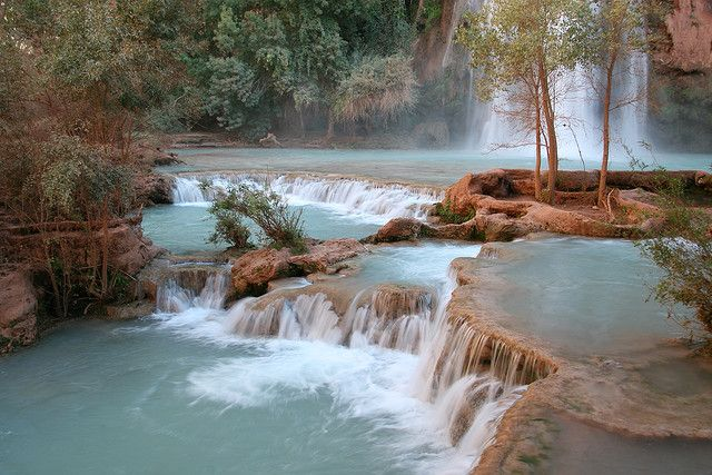The Havasu Canyon is part of the Grand Canyon and is inhabited by the Havasupai tribe, who live in the small town of Supai. It is one of the most remote villages in America and normal access is via a helicopter ride or a 13 km (8 mile) dusty horse trail from a car park at Hualapai Hilltop