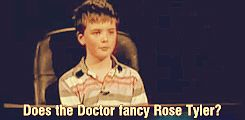 """A little boy asks Christopher Eccleston if the Doctor fancies Rose Tyler.  Click to see his response."" I just grinned like an idiot."