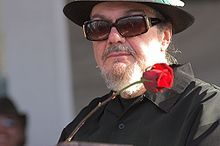"""Dr. John aka Malcolm John """"Mac"""" Rebennack, Jr. (born November 21, 1940), better known by the stage name Dr. John (also Dr. John Creaux), is an American singer-songwriter, pianist and guitarist, whose music combines blues, pop, jazz as well as zydeco, boogie woogie and rock and roll"""