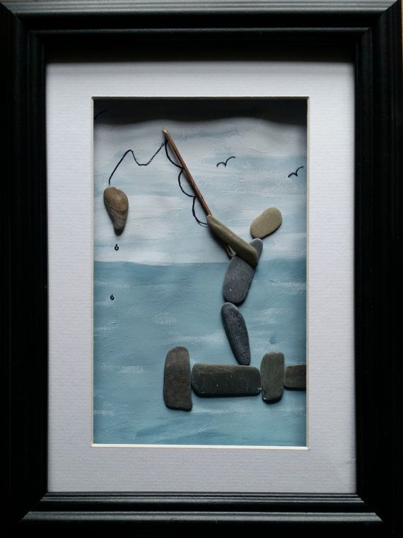 A unique handcrafted pebble artwork in a glazed frame.  Frames available in either black, white or dark wood   Or order a custom made pebble