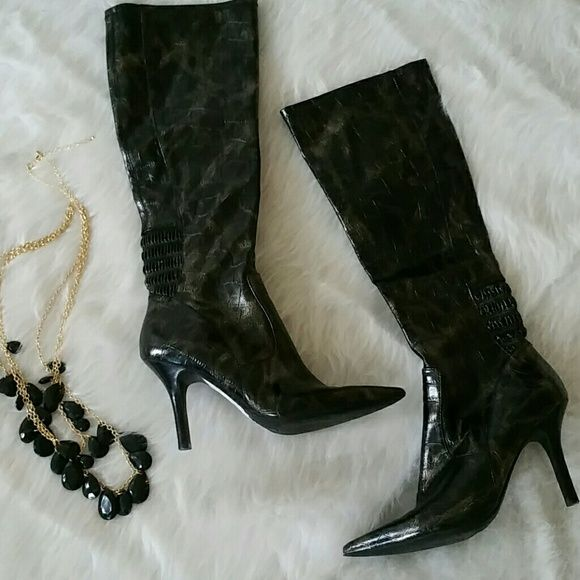 Womans boots Great condition womans animal print boots. Zip up inside with elastic. Slight wear on toes. Not noticable when wearing. Color is black with bronze highlight. Nine West Shoes Heeled Boots