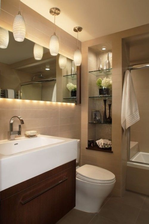 Bathroom remodel ideas - put divider wall next to toilet w/ shelving.  Create a cube on other side w/ towel hooks, then built in pull out trash can.  Then keep original double sinks, but push farther apart to put a vanity in middle.