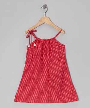 Sweethearts will feel submerged in loving warmth when pulling on this sweet dress. With a darling print and ties in front to keep it securely fastened, this wonderful piece will have little lovelies enjoying everything the afternoon sun has to offer.