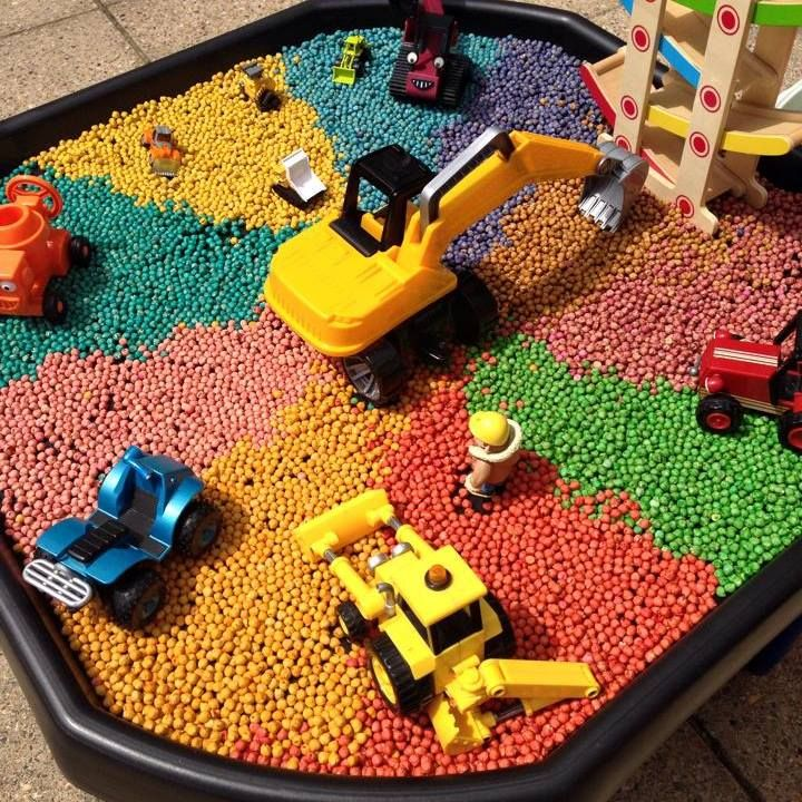 "Rainbow chickpeas tuff tray. Fancy doing something like this for next week Petra? It's ""colour"" ""rainbow fun"" week! Or any other ideas you have!"