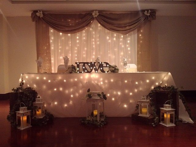 Rustic backdrop and head table decor by Boutique Linen Rentals