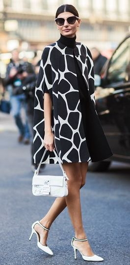 Giovanna Battaglia during Paris Fashion Week, Spring 2013. 1960s style capecoat