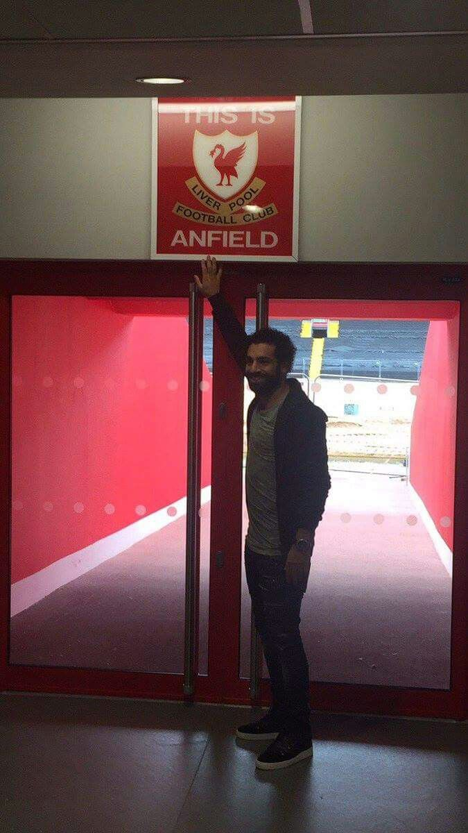 23 June 2017 Salah touching the 'This is Anfield' sign