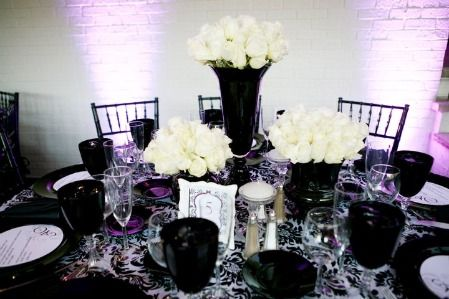 Using black vases with white flowers is very dramatic. The lighting in the background also helps!