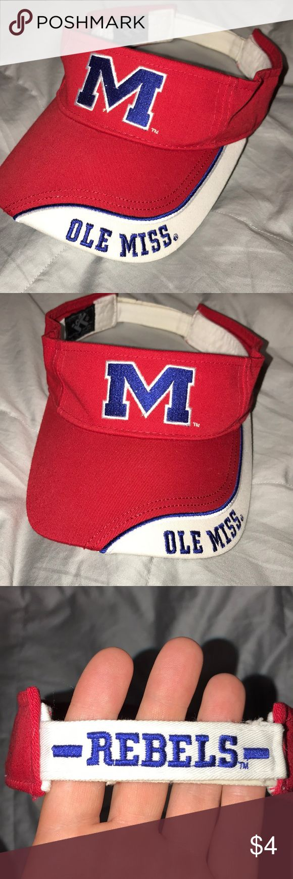 Ole Miss visor Ole Miss visor! Worn just a couple times, I've already washed so it's nice and clean. Just a little discolor on the one spot on the inside or the hat but other than that it's awesome sports wear Accessories Hats
