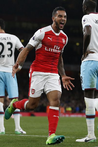 Arsenal's English midfielder Theo Walcott celebrates after scoring their second goal during the English Premier League football match between Arsenal and West Ham United at the Emirates Stadium in London on April 5, 2017.  / AFP PHOTO / Ian KINGTON / RESTRICTED TO EDITORIAL USE. No use with unauthorized audio, video, data, fixture lists, club/league logos or 'live' services. Online in-match use limited to 75 images, no video emulation. No use in betting, games or single club/league/player…