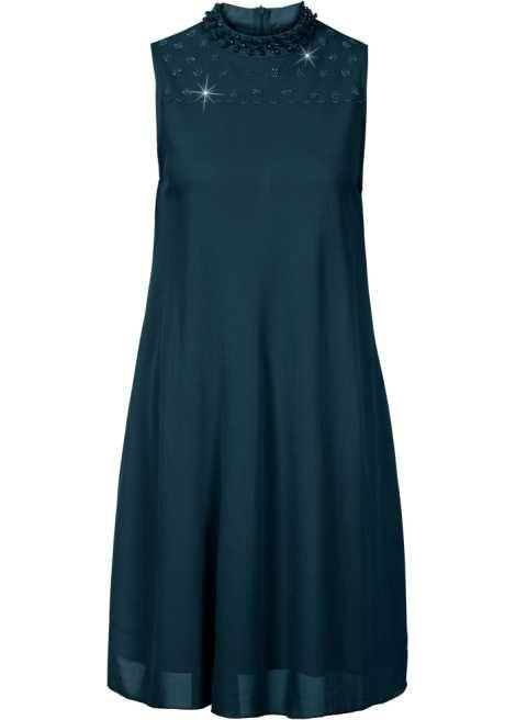 Bekijk nu:Prachtige jurk van BODYFLIRT met kraaltjes bij het decolleté. De ritssluiting op de rug biedt comfort bij het aan- en uittrekken. Lengte in mt. 36/38 ca. 90 cm.