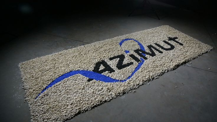 Azimut logo, made out of pebbles as a welcome