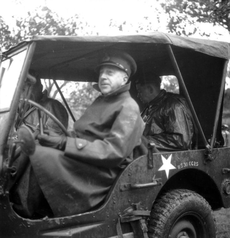 General Harry Crerar at the wheel of his Jeep