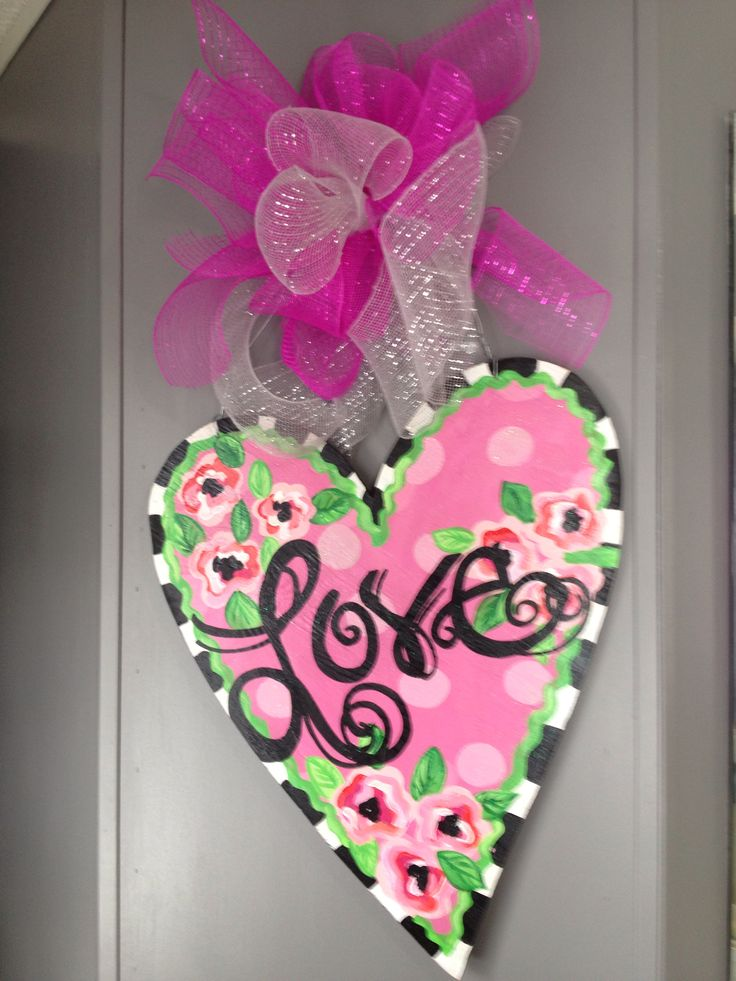 I painted this heart shaped door hanger for Valentines day! Plywood, acrylics and mesh ribbon