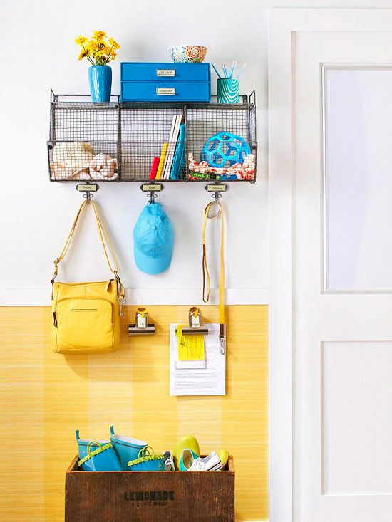 Organized Entry How to make it: Place a divided bin on the wall for organizing gear. Install a few sturdy hooks for bags, hats, and coats. Use smaller hooks to hang large binder clips to organize important papers that you'll need to grab before leaving the house. Position a large bin or box below the installation as a catchall for other items