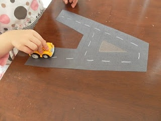 """make """"road"""" letters for handwriting practice - the child drives the car over the road shape, practicing making the letter"""