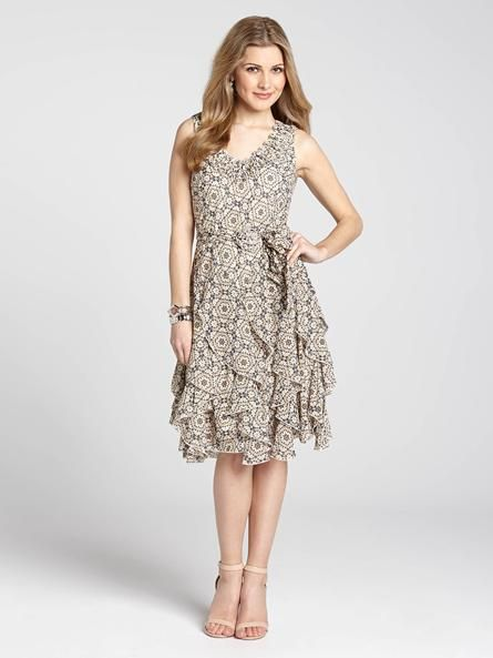 """Laura Petites: for women 5'4"""" and under. Spring just wouldn't be Spring without the perfect sundress, so slip into this piece and let the sun shine on you! Featuring a chic medallion print with a ruffle neck and corkscrew hem, it's a lovely...4010101-0433"""