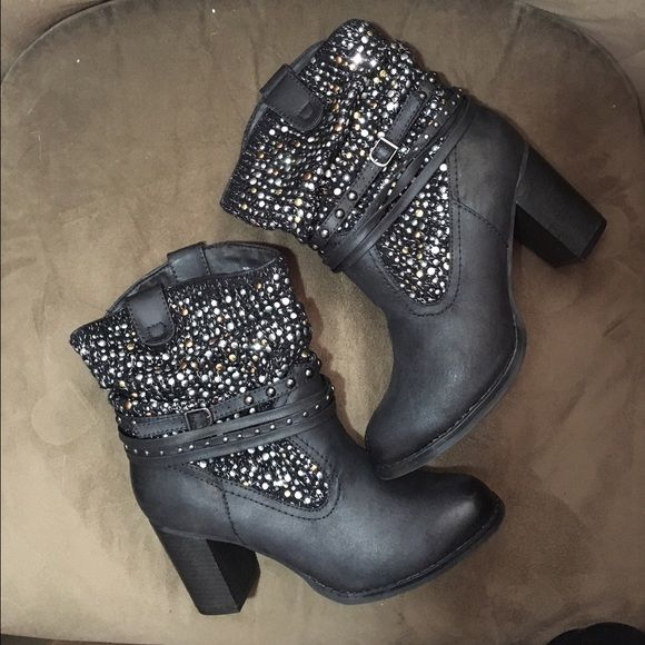 NWT Not Rated Black Boots Super cute black with gold bronze and silver never worn, still in box! Heel is about 3 inches!so cute with so many outfits!! Not Rated Shoes Ankle Boots & Booties