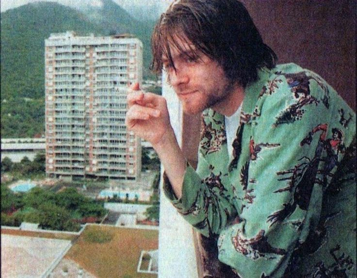 This photo i believe was taken in Rio?? Well wherever it was taken , I read in a biography about Kurt that multiple times he tried to jump of the balconies and so he kept being moved hotels and it was hard to find any hotels that wasn't tall
