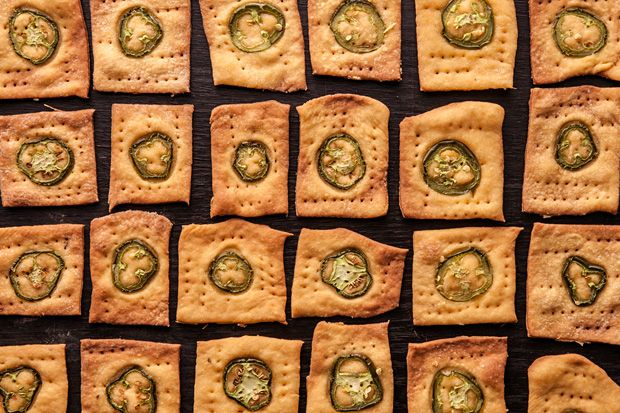 """Crisp, cheese-flavored crackers made with yeast, """"00"""" flour, a mac and cheese seasoning packet, and sliced jalapeños."""