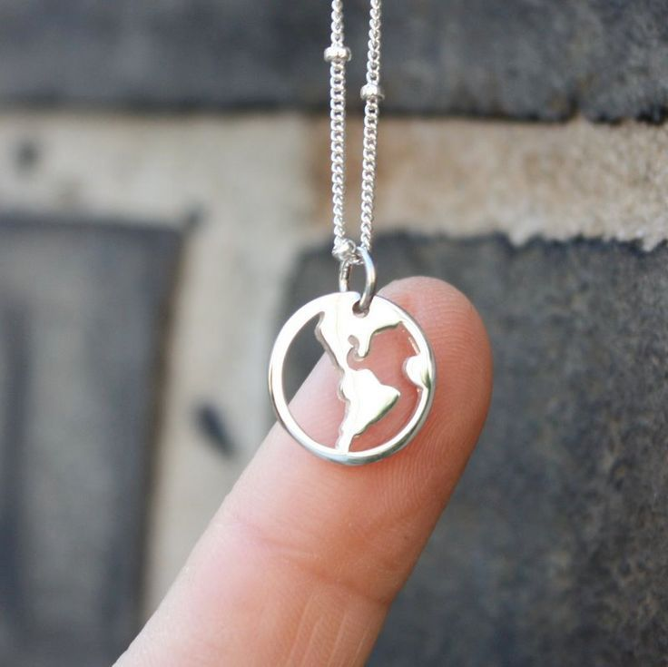 World Map Necklace - Sterling Silver Globe Pendant . Traveler Jewelry . World Charm . Gifts for Her. $38.00, via Etsy.