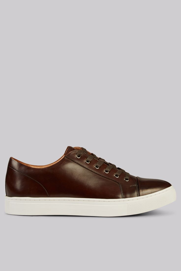 John White Brown Halcyon Sneaker Dress up your dressed-down attire. Retain your cool smart appearance when a day calls for casual dress with these brown leather sneakers by John White. Fuss-free with a simple design and a chunky whit http://www.MightGet.com/march-2017-1/john-white-brown-halcyon-sneaker.asp