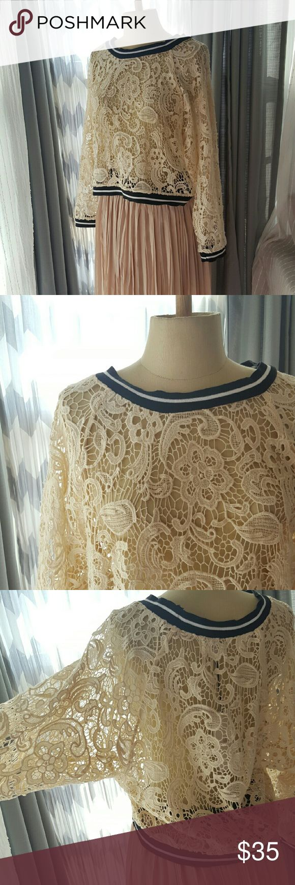 "NATURAL BEAUTY crochet lace batwing top Stand out in this gorgeous, batwing crochet top with varsity black/white neckline and cuff detail. Crochet is a natural cream color. Perfect with vegan leather skirt listed in this closet!  All measurements laying flat. Length: 18"" Bust: 16"" Blush skirt is not for sale. No size - but it fit me and I'm a Medium. Pretty forgiving on both Sm and Medium. Lucca Couture Tops"