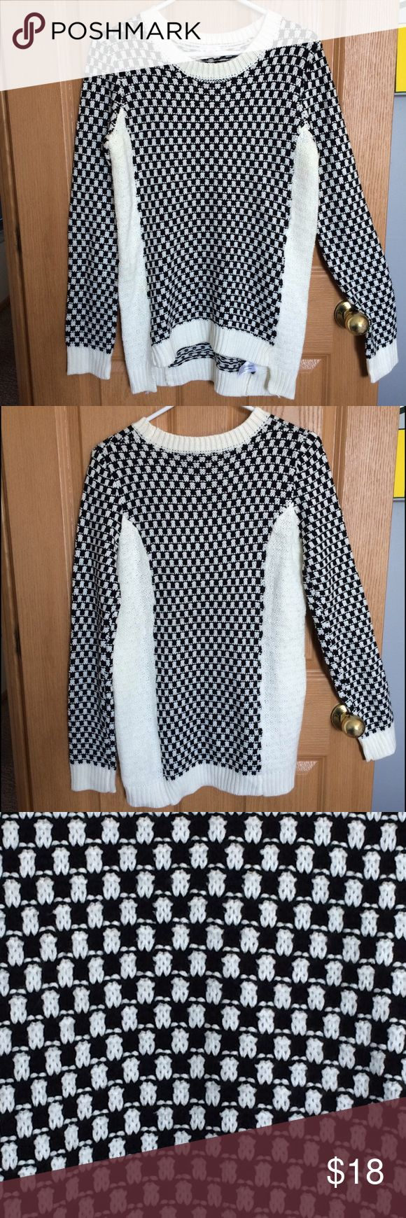 Long sleeve crew neck sweater Black & white checkered body & sleeve pattern with white neckline trim, sleeve cuffs & down the sides of body. Super, super comfortable & soft. Worn twice! Slightly longer length in the back. 100% acrylic. Xhilaration Sweaters Crew & Scoop Necks