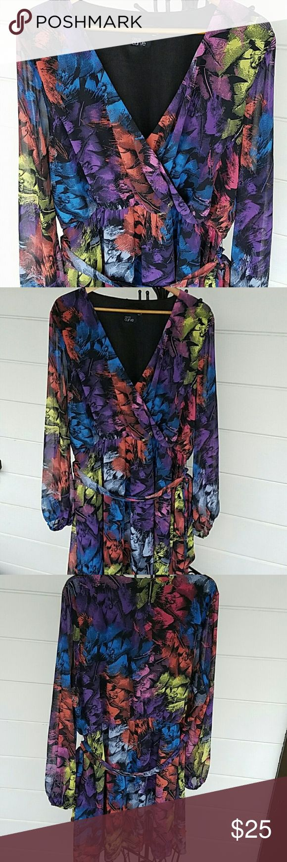 """Multicolored ASOS Curve cinched in waist dress On trend with the cinched in waist. I am a size 20 but the arm sleeves were too long for me and the dress came to knees. (I'm5'6""""). Lovely floaty top fabric with black underlining for seamless curve showing. ASOS Curve Dresses Midi"""