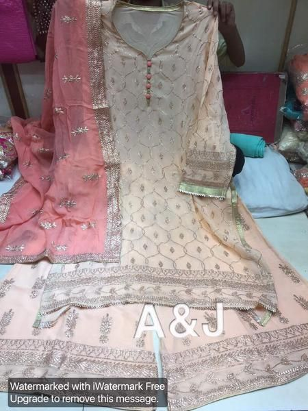 Pure georgette very fine badla work check on shirt & ghera & same work on ready plazo with pure georgett badla work. Comes with contrast dupattaplazo s