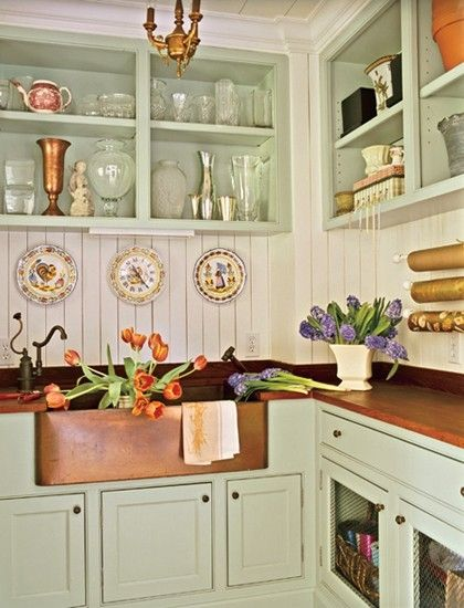 copper sink, bead board backsplash, open shelving, wood counters, green painted cabinets