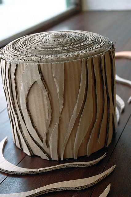 "cardboard log pin.  We use this technique on large tubes meant for construction.  Using 12"" diameter cardboard tubes with these applied strips.  The logs or stumps are very realistic."