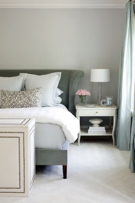 Bedroom decor ideas - traditional style with light green, grey and white colors. Green velvet upholstered headboard and white nightstand.