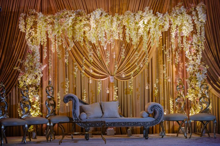 Yanni Design Studio created their signature stunning drapery in gold with beautiful floral backdrops and hanging candles.