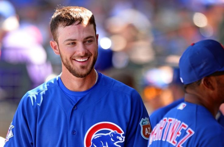 Mar 27, 2016; Mesa, AZ, USA; Chicago Cubs third baseman Kris Bryant (17) smiles in the dugout during the third inning against the Seattle Mariners at Sloan Park. Mandatory Credit: Jake Roth-USA TODAY Sports