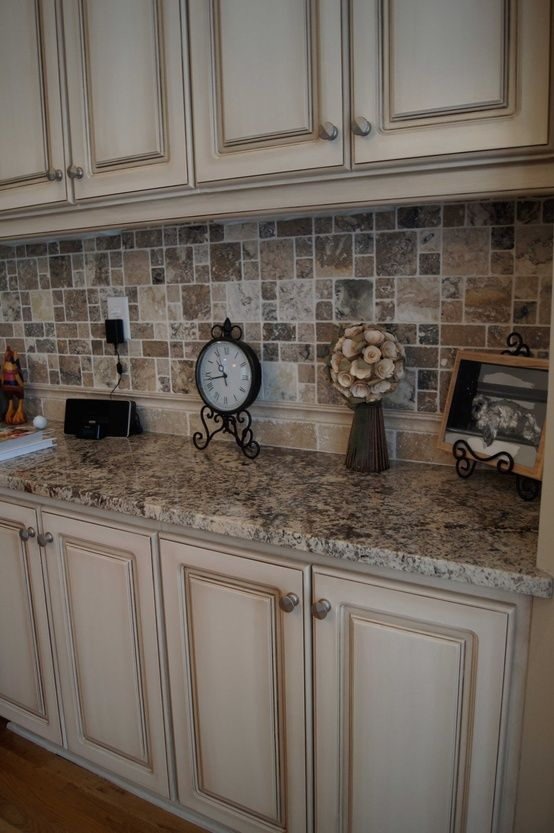 Cabinets refinished to a custom off white finish with heavy glaze.  LOVE the tile back splash.