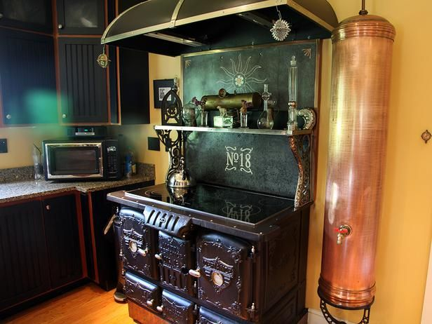 Steampunk kitchen:  This 1800s wood-fired cook-stove was retrofitted with a glass cooktop and two electric ovens...