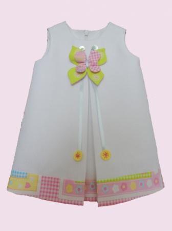vestido de niña elaborado en tela de piqué, forrado en tela de algodón, con adorno vestido de niña tela de piqué blanco,forro de algodón,adorno en tela de algodón confección a máquina,confección a mano