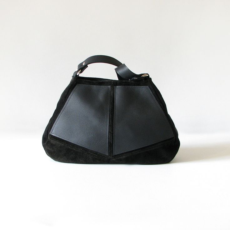 The sleek handmade Diamond Hobo handbag is made from quality jersey suede with cowskin leather panels.